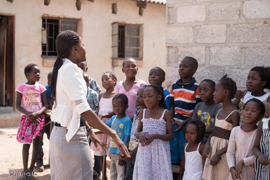 Sunday school teacher with a few of the children
