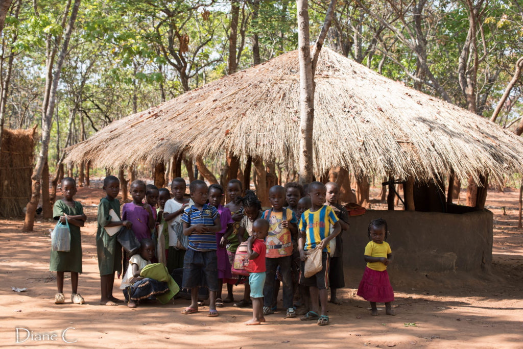 The nursery school building with the children arriving